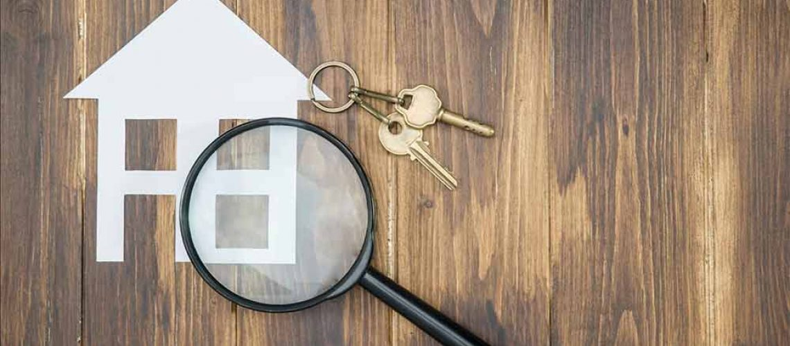 house with keys and magnifying glass